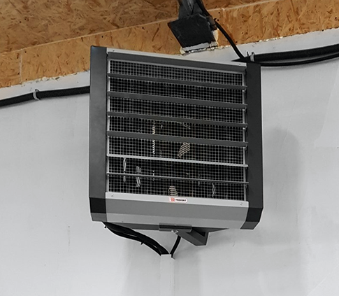 Heating of a manufacturing workshop with a fan heater